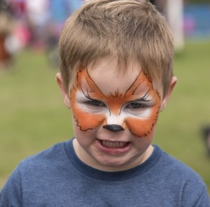 Tiger face paint growling